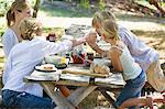 Family having food at front or back yard Stock Photo - Premium Royalty-Freenull, Code: 6108-05871688
