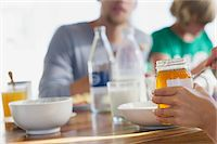 Family having breakfast at a dining table Stock Photo - Premium Royalty-Freenull, Code: 6108-05871696