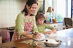 Grandmother and little boy kneading dough at kitchen Stock Photo - Premium Royalty-Free, Artist: Photocuisine, Code: 6108-05871765