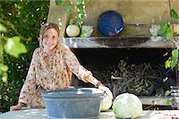 preteen girls bath - Portrait of a little girl with cabbage on table outdoors Stock Photo - Premium Royalty-Freenull, Code: 6108-05871774