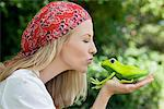 Young woman kissing a frog toy Stock Photo - Premium Royalty-Free, Artist: Robert Harding Images, Code: 6108-05871843