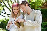 Young couple knitting together and smiling Stock Photo - Premium Royalty-Free, Artist: urbanlip.com, Code: 6108-05871849