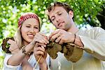 Young couple knitting together and smiling Stock Photo - Premium Royalty-Free, Artist: Raymond Forbes, Code: 6108-05871876