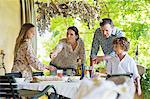 Family preparing for food at house Stock Photo - Premium Royalty-Freenull, Code: 6108-05871924