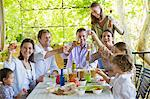 Multi generation family eating food at house Stock Photo - Premium Royalty-Free, Artist: Cultura RM, Code: 6108-05871948
