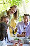Happy family having drink at home Stock Photo - Premium Royalty-Free, Artist: Susan Findlay, Code: 6108-05871963