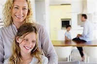 Close-up of a woman and her daughter smiling together Stock Photo - Premium Royalty-Freenull, Code: 6108-05872037