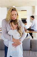 Mother hugging her daughter and smiling Stock Photo - Premium Royalty-Freenull, Code: 6108-05872066