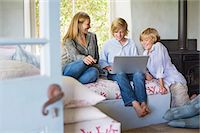 Children and their mother using laptop at house Stock Photo - Premium Royalty-Freenull, Code: 6108-05872071