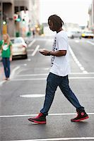 Side profile of a man text messaging on a mobile phone Stock Photo - Premium Royalty-Freenull, Code: 6108-05872141
