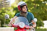 Man riding a scooter Stock Photo - Premium Royalty-Free, Artist: Robert Harding Images, Code: 6108-05872152