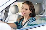 Portrait of a beautiful young woman sitting at driver's seat Stock Photo - Premium Royalty-Free, Artist: Cultura RM, Code: 6108-05872222
