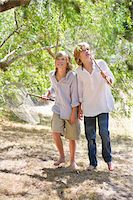 Little boys looking away in forest with net in hand Stock Photo - Premium Royalty-Freenull, Code: 6108-05872660