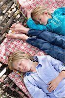 Tired little siblings sleeping in hammock Stock Photo - Premium Royalty-Freenull, Code: 6108-05872695