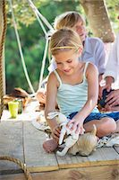 Children playing with toys in tree house Stock Photo - Premium Royalty-Freenull, Code: 6108-05872731