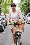 Woman carrying vegetables on a bicycle, Paris, Ile-de-France, France Stock Photo - Premium Royalty-Free, Artist: GreatStock, Code: 6108-05872800