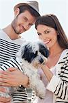 Couple carrying a puppy, Paris, Ile-de-France, France Stock Photo - Premium Royalty-Free, Artist: ableimages, Code: 6108-05872803
