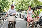 Couple carrying vegetables on bicycles, Paris, Ile-de-France, France Stock Photo - Premium Royalty-Free, Artist: ableimages, Code: 6108-05872815