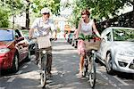 Couple carrying vegetables on bicycles, Paris, Ile-de-France, France Stock Photo - Premium Royalty-Free, Artist: Ikon Images, Code: 6108-05872843