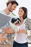 Couple carrying a puppy, Paris, Ile-de-France, France Stock Photo - Premium Royalty-Free, Artist: ableimages, Code: 6108-05872852
