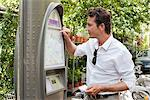 Man looking a map in a ticket machine, Paris, Ile-de-France, France Stock Photo - Premium Royalty-Free, Artist: Amy Whitt, Code: 6108-05872873