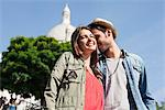 Low angle view of a couple, Montmartre, Paris, Ile-de-France, France Stock Photo - Premium Royalty-Free, Artist: ableimages, Code: 6108-05872926