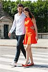 Couple walking with arms around and smiling, Paris, Ile-de-France, France Stock Photo - Premium Royalty-Free, Artist: ableimages, Code: 6108-05872950