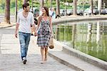 Couple walking near a canal and smiling, Paris, Ile-de-France, France Stock Photo - Premium Royalty-Free, Artist: ableimages, Code: 6108-05872953