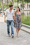Couple walking near a canal and smiling, Paris, Ile-de-France, France Stock Photo - Premium Royalty-Free, Artist: ableimages, Code: 6108-05872986