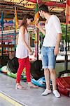 Couple in an amusement park, Paris, Ile-de-France, France Stock Photo - Premium Royalty-Free, Artist: Ikon Images, Code: 6108-05873068
