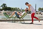 Woman covering eyes of a man with her hands, Bassin octogonal, Jardin des Tuileries, Paris, Ile-de-France, France Stock Photo - Premium Royalty-Free, Artist: ableimages, Code: 6108-05873073