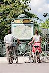 Couple with bicycles looking at a map, Paris, Ile-de-France, France Stock Photo - Premium Royalty-Free, Artist: Siephoto, Code: 6108-05873166