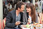Couple enjoying lunch at a restaurant, Paris, Ile-de-France, France Stock Photo - Premium Royalty-Free, Artist: ableimages, Code: 6108-05873178