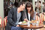Romantic couple at a restaurant, Paris, Ile-de-France, France Stock Photo - Premium Royalty-Free, Artist: Ikon Images, Code: 6108-05873196