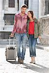 Couple walking on a road with a suitcase, Paris, Ile-de-France, France Stock Photo - Premium Royalty-Free, Artist: Ikon Images, Code: 6108-05873203