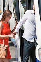 Couple boarding in a bus, Paris, Ile-de-France, France Stock Photo - Premium Royalty-Freenull, Code: 6108-05873212