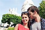 Man kissing a woman smiling, Montmartre, Paris, Ile-de-France, France Stock Photo - Premium Royalty-Free, Artist: ableimages, Code: 6108-05873239