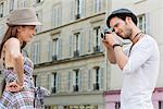 Man taking a picture of a woman standing with her hand on her hip, Paris, Ile-de-France, France Stock Photo - Premium Royalty-Free, Artist: ableimages, Code: 6108-05873244