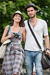 Couple walking on a road and smiling, Paris, Ile-de-France, France Stock Photo - Premium Royalty-Free, Artist: ableimages, Code: 6108-05873253