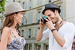 Man taking a picture of a woman, Paris, Ile-de-France, France Stock Photo - Premium Royalty-Free, Artist: ableimages, Code: 6108-05873262