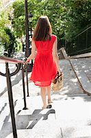 Woman moving down staircases, Montmartre, Paris, Ile-de-France, France Stock Photo - Premium Royalty-Freenull, Code: 6108-05873298