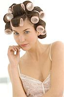 Portrait of a young woman in curlers Stock Photo - Premium Royalty-Freenull, Code: 6108-05873442