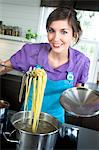 Young smiling woman cooking pasta Stock Photo - Premium Royalty-Free, Artist: CulturaRM, Code: 6108-05873463