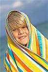 Boy wrapped in a towel and smiling Stock Photo - Premium Royalty-Free, Artist: Aflo Sport, Code: 6108-05873700