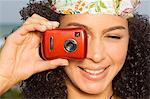 Close-up of a woman taking a picture with a digital camera Stock Photo - Premium Royalty-Free, Artist: CulturaRM, Code: 6108-05873743