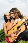 Couple playing a guitar Stock Photo - Premium Royalty-Free, Artist: AWL Images, Code: 6108-05873745