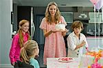 Woman with three children at a birthday party Stock Photo - Premium Royalty-Free, Artist: Ikonica, Code: 6108-05874075