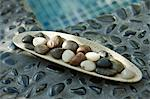 Close-up of pebbles in a tray Stock Photo - Premium Royalty-Free, Artist: Blend Images, Code: 6108-05874102