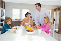 Family having breakfast at the dining table Stock Photo - Premium Royalty-Freenull, Code: 6108-05874165