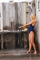 Girl under a beach shower Stock Photo - Premium Royalty-Freenull, Code: 6108-05874300